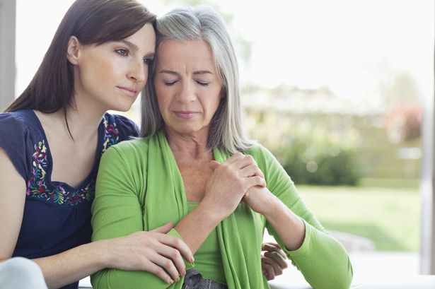 Woman consoling sad mother-1163082