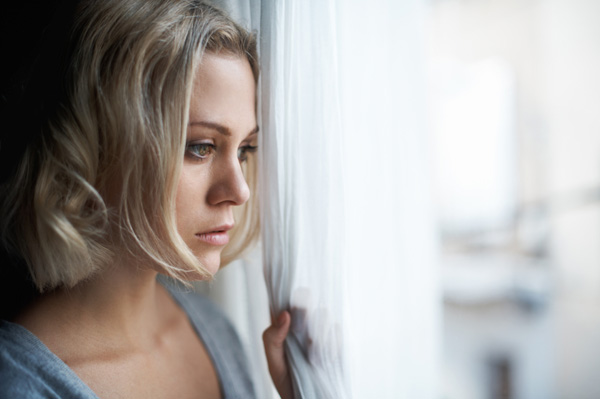 sad-woman-looking-out-window