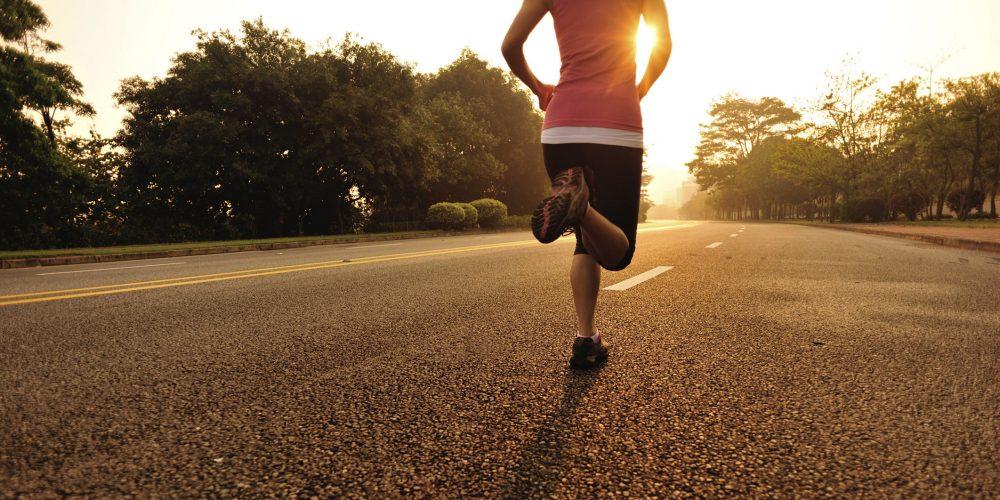 woman running on roa