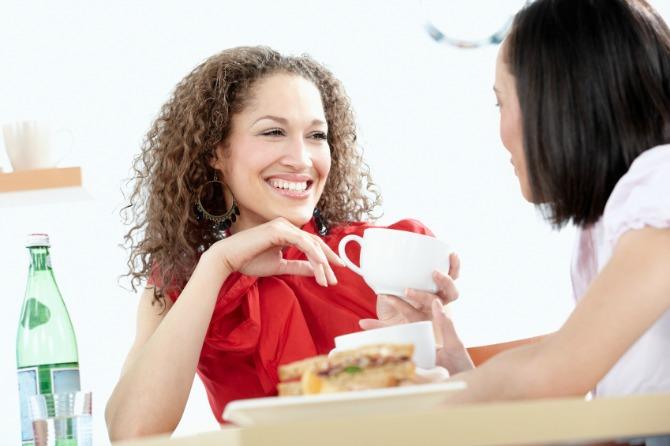 two mixed race women enjoy a cofee break after shopping