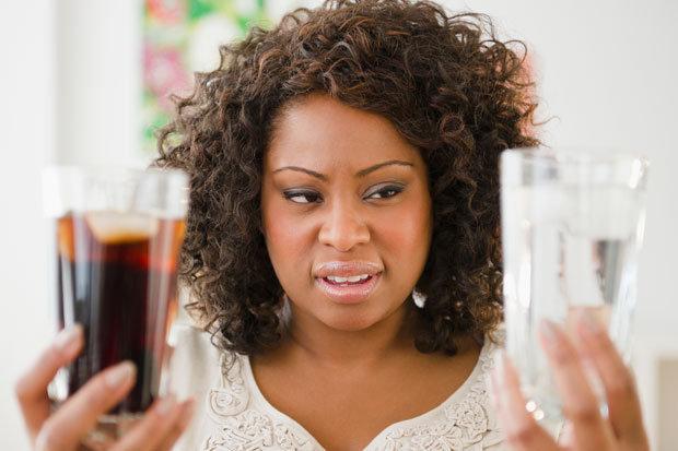 woman holding soda