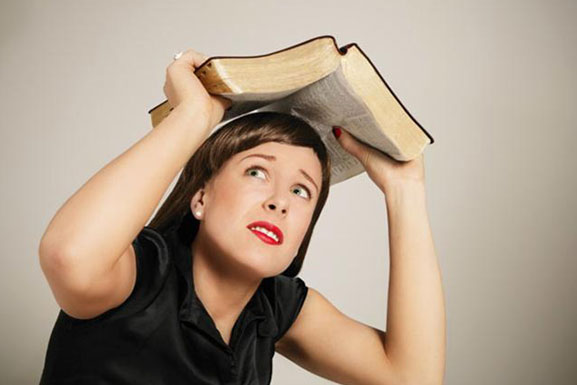 woman-hiding-under-bible