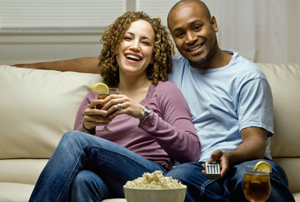 couple-couch-remote-tv
