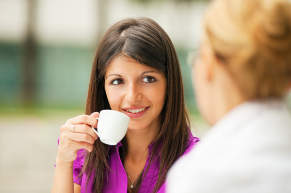woman-having-coffee-with-friend
