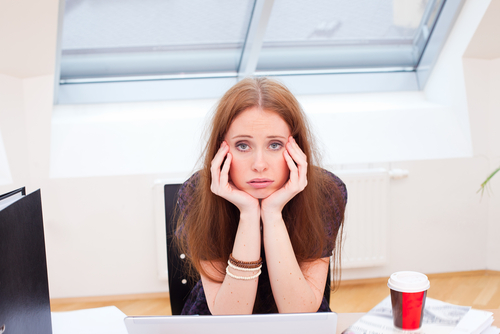 fed-up-woman-at-desk