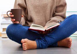 woman reading a book on singlehood