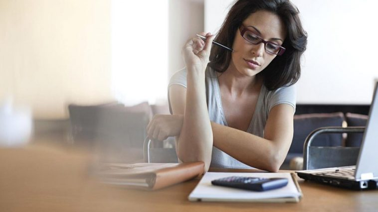 woman stressing over finances