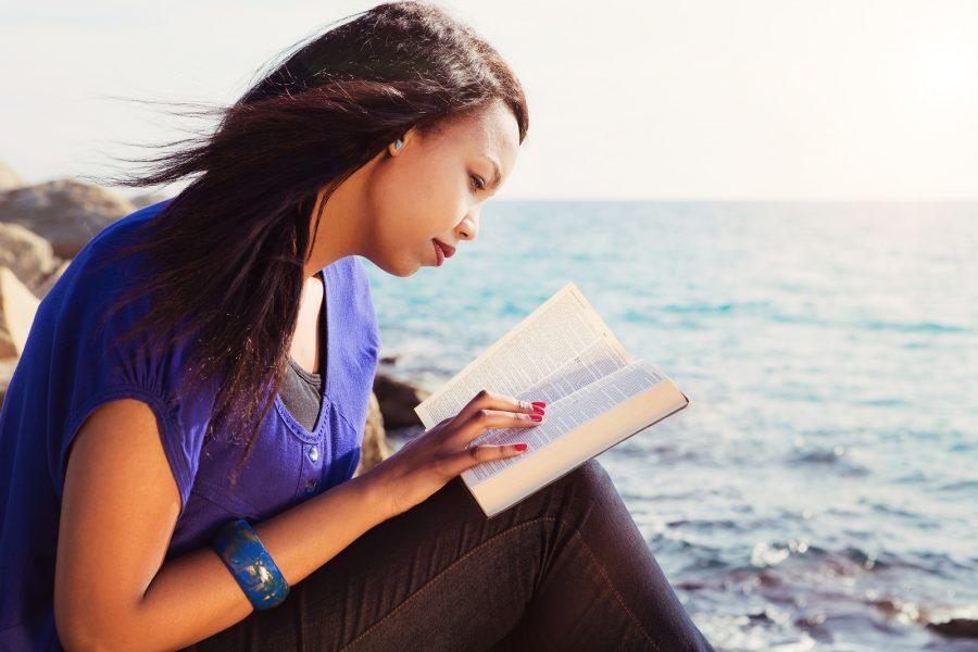 Girl reading a Bible