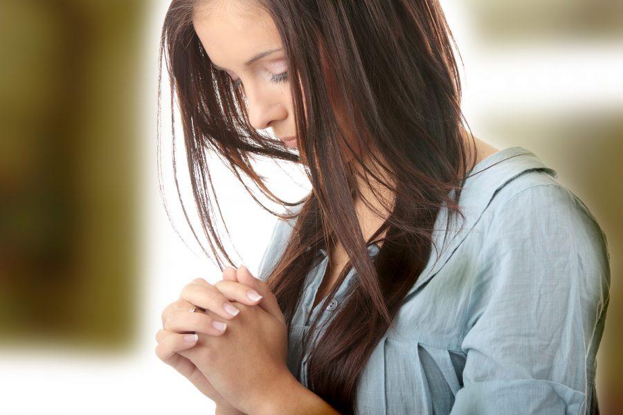 woman in blue praying