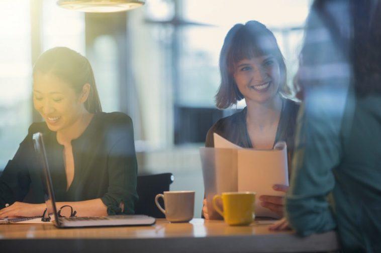 women talking business